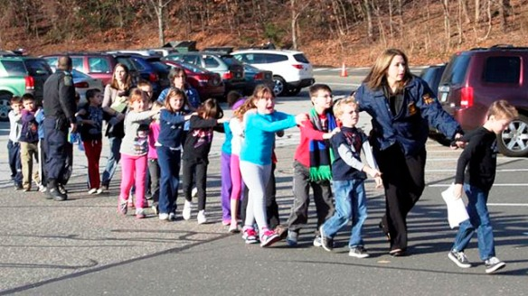 Dec. 14, 2012 Frightened children file out of school after shooting massacre.